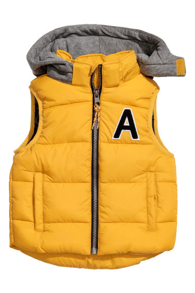 Padded gilet with a hood - Mustard yellow - Kids | H&M CN