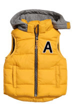 Padded gilet with a hood - Mustard yellow - Kids | H&M CN 2