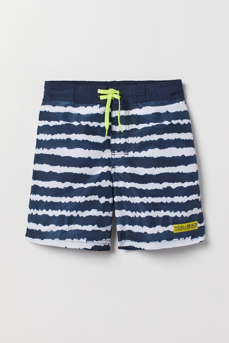 Patterned swim shorts - Dark blue/White striped - Kids | H&M GB