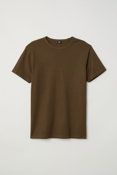 T-shirt in piqué di cotone - Verde kaki scuro - UOMO | H&M IT