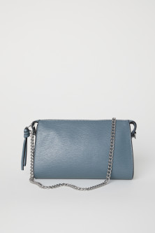 Clutch bag with a metal chain