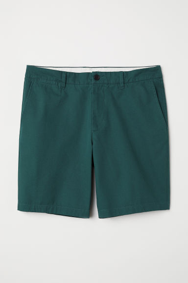 Shorts modello chinos - Verde scuro - UOMO | H&M IT