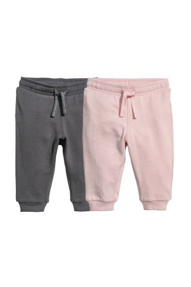 2-pack cotton joggers - Powder pink/Dark grey - Kids | H&M CN