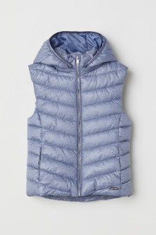 Padded gilet with a hood
