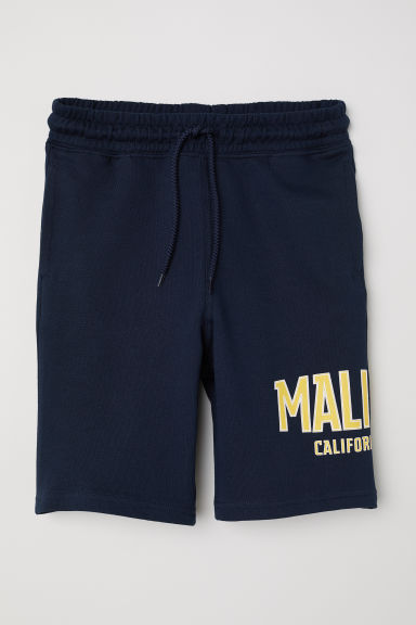 Patterned sweatshirt shorts - Dark blue/Malibu - Kids | H&M CN