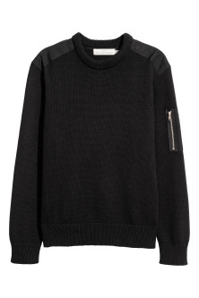 Jumper with a sleeve pocket