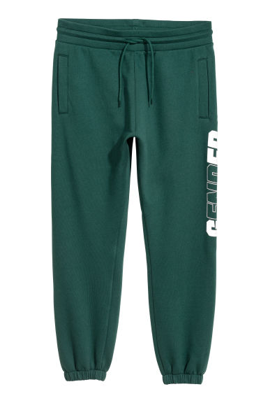Printed sweatpants - Dark green/Gender -  | H&M IE