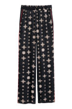 Wide pull-on trousers - Dark blue/Patterned - Ladies | H&M IE 1