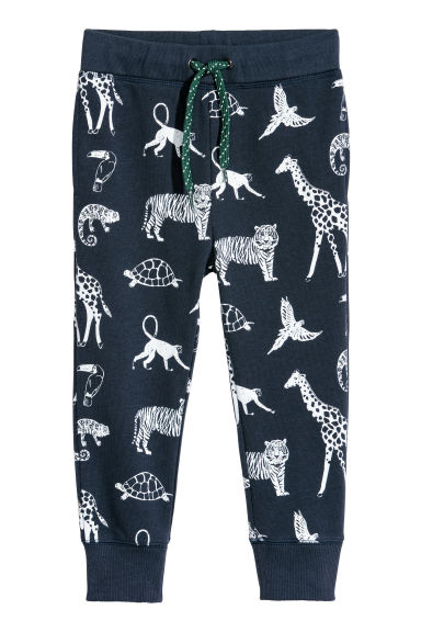 Printed joggers - Dark blue/Jungle animals -  | H&M