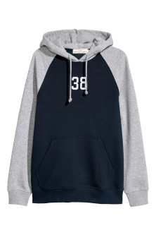 Hooded top with a motif