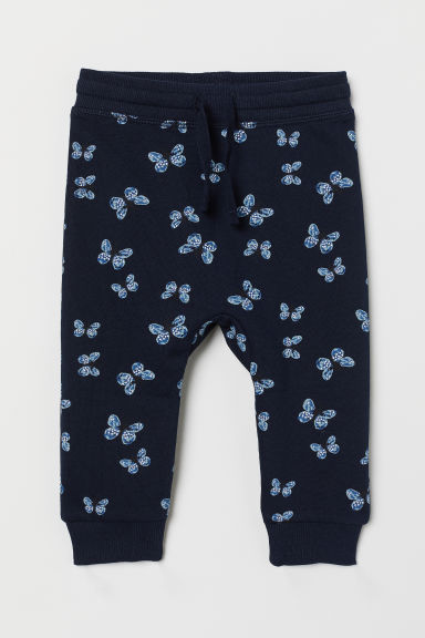 Cotton joggers - Dark blue/Butterflies - Kids | H&M CN