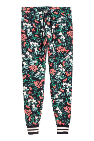 Patterned joggers - Dark blue/Floral - Ladies | H&M GB