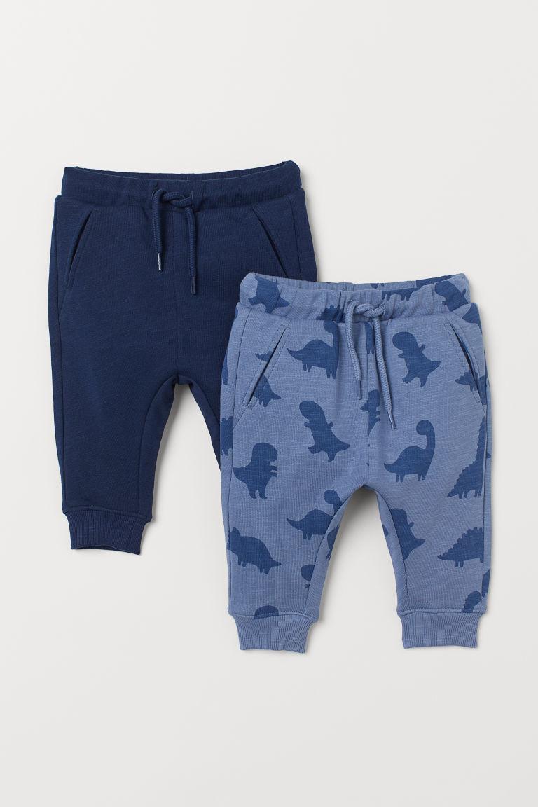 2-pack cotton joggers - Blue/Dinosaurs - Kids | H&M GB