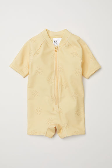 Swimsuit with UPF 50 - Light yellow/Sunbursts - Kids | H&M CN