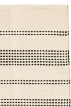 Textured striped cotton rug - Natural white/Anthracite grey - Home All | H&M IE 2