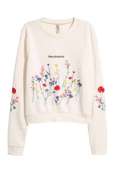 Embroidered sweatshirt - Cream/Flowers -  | H&M IE