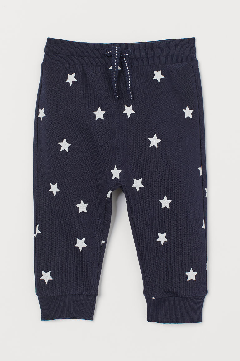 Cotton joggers - Dark blue/Stars - Kids | H&M GB