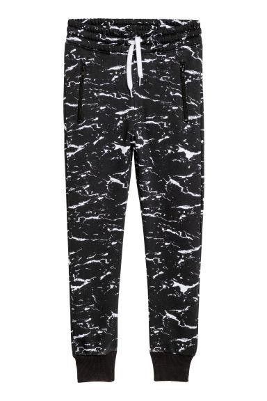 Patterned joggers - Black/Marble-patterned - Kids | H&M CN