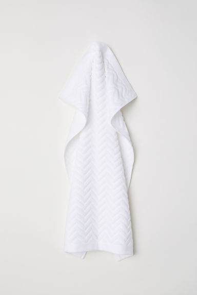 Jacquard-patterned hand towel - White - Home All | H&M GB