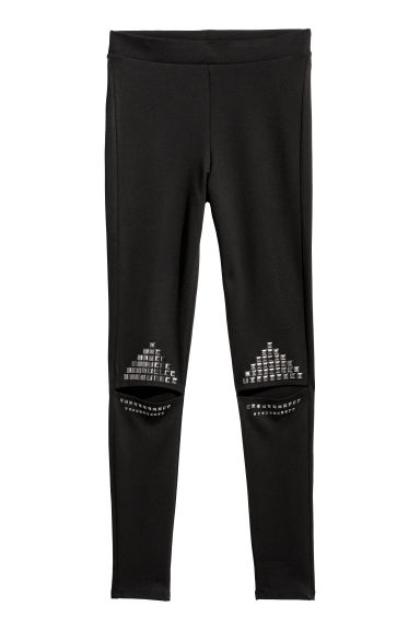 Cut-out leggings with studs - Black - Ladies | H&M