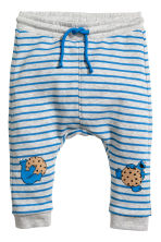 Printed joggers - Light grey/Cookie Monster - Kids | H&M CN 1