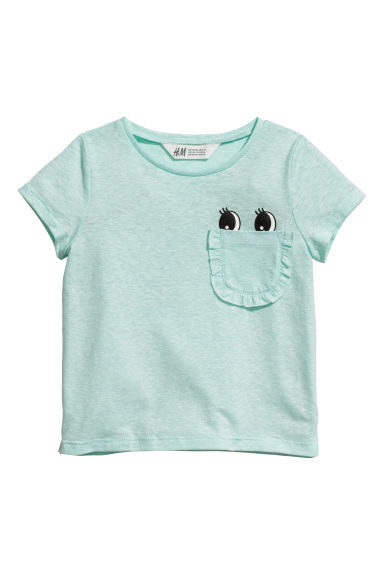 T-shirt with a chest pocket - Mint green/Eyes - Kids | H&M CN