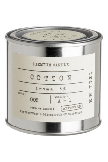 Scented candle in a metal tin