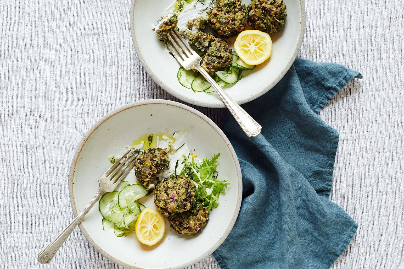 Lentil cakes served with lemon, cucumber and Greek yoghurt.
