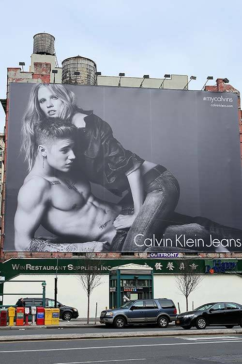 Lara Stone and Justin Bieber in the recent Calvin Klein ad, All Over Press.