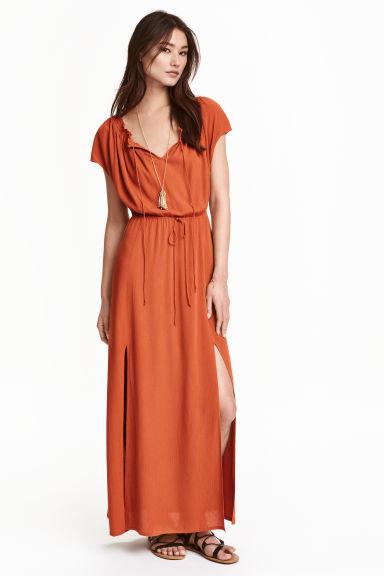 Orange off the shoulder maxi dress