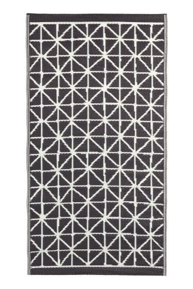tapis jacquard en plastique noir motif home all h m fr. Black Bedroom Furniture Sets. Home Design Ideas
