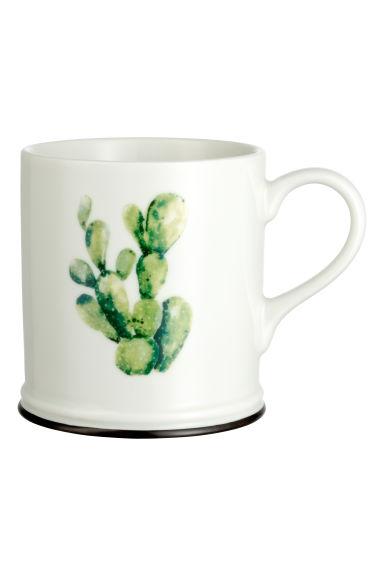 mug en porcelaine avec motif blanc cactus h m fr. Black Bedroom Furniture Sets. Home Design Ideas