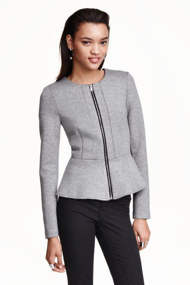 Wear a statement jacket over the peplum top. A blazer can also be worn with pants and shorts. Another option would be to wear it with narrow pants and peplum top with lace on it.