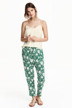 Woven joggers - Dark green/Patterned - Ladies | H&M CN 1