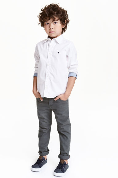Pantaloni in twill Regular fit - Grigio scuro - BAMBINO | H&M IT