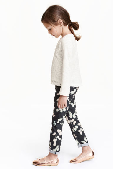 Stretch trousers - Black/Butterfly - Kids | H&M CN