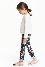 Stretch trousers - Black/Butterfly - Kids | H&M CN 1