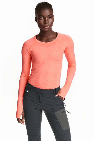 Top training sans coutures - Orange fluo chiné - FEMME | H&M FR