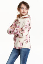 Hooded top with a motif - Light beige/Roses - Kids | H&M CN 1