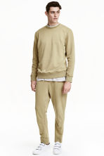Joggers - Light khaki green - Men | H&M CN 1