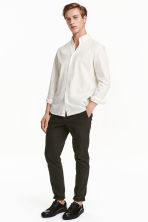 Chinos Skinny fit - Dark khaki green - Men | H&M 1