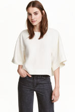 Oversized lyocell top - Natural white - Ladies | H&M CN 1