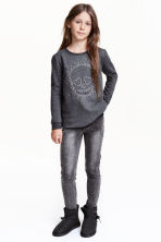 Pantaloni super-stretch - Nero Washed out - BAMBINO | H&M IT 1