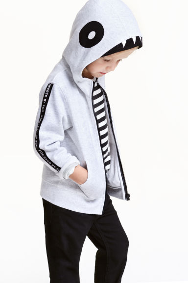 Hooded jacket with appliqués