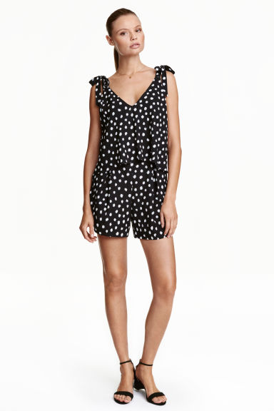 Patterned playsuit - Black/Spotted - Ladies | H&M CN