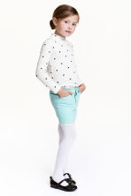 Corduroy skirt with lace - Mint green/Glittery - Kids | H&M CN 1