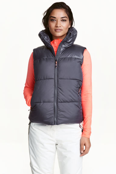 Padded gilet with high collar Model