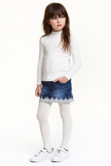 Denim skirt with embroidery Model