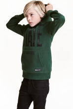 Hooded top with a print motif - Dark green - Kids | H&M CN 1