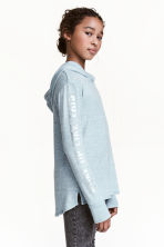Hooded top with a print motif - Mint green marl -  | H&M CN 1